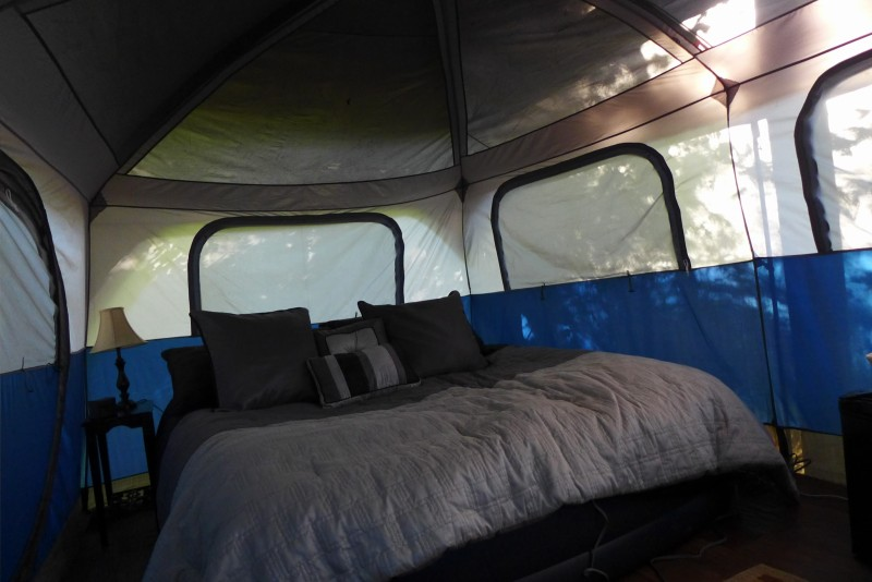 Itu0027s a big Coleman tent on a platform with an extra roof and electricity furniture inside and out a refrigerator and snacks and a big air mattress with ... & glamping | Squirrels and Tomatoes