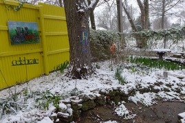 spring garden in the snow