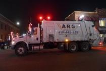 Lit Garbage Truck