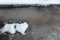 ice moat in the gutter on Adams Ave