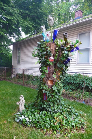 bottle tree with bottles on it once more
