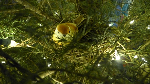 a fake bird on a real nest that came with the tree